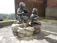 Garden water feature fountain with children, boy and girl, with rock effect base, rarely used.