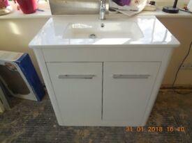 Washbasin with floor mounted vanity unit
