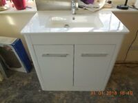 Washbasin with floor mounted vanity unit