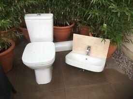 Roca pedestal sink and toilet