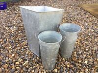 Set of three metal garden containers