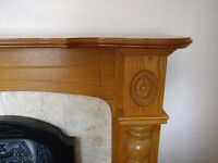 Wooden fireplace surround and electric fire