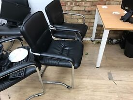 Black leather office visitor chairs