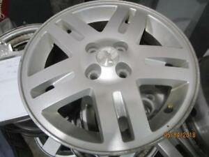 SET OF 4 MATCHING USED CHEV COBALT ALLOY RIMS IN VERY GOOD SHAPE