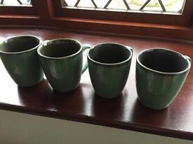 Four green mugs