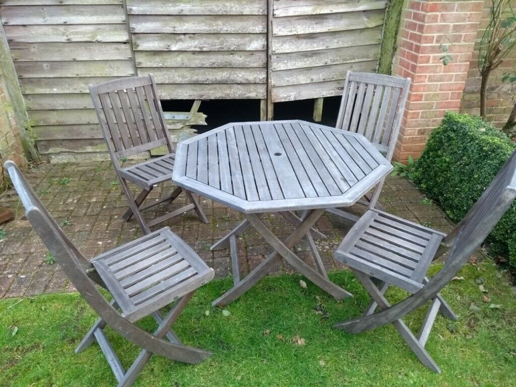 Outdoor hardwood table and four chairs