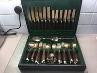 Bronze & Rosewood canteen of cutlery