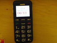 MOBILE PHONE WITH CHARGER IDEAL FOR PARTIALLY SIGHTES HAS BIG NUMBERS AND VOICE CONFIRMATION