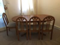 Used Extendable Dining Table And Four Chairs
