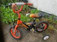 Boy's bike with stabilisers