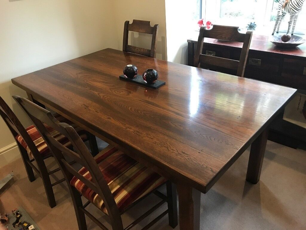 Beautiful solid mahogany table and 8 upholstered chairs