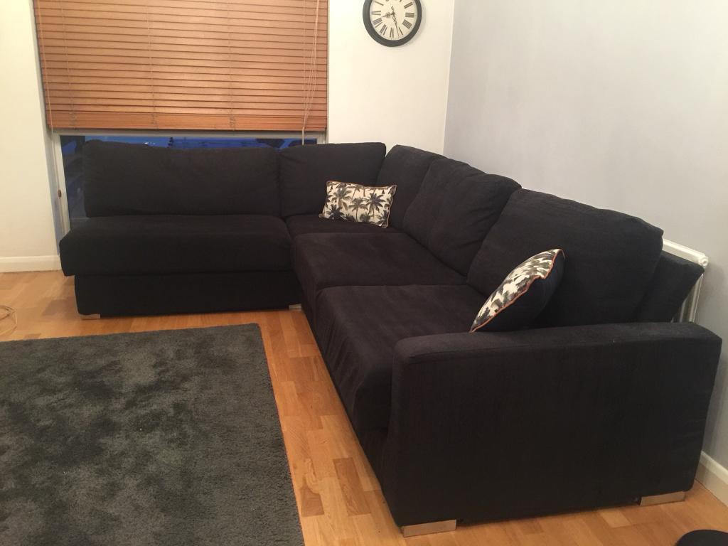 Black Nabru L shape corner sofa bed to sit 4 to 6 people