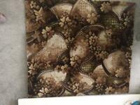 Carpet. Rug size. New. Brown/beige floral design.Hessian backed 1040 x 920mm. Collection NG6