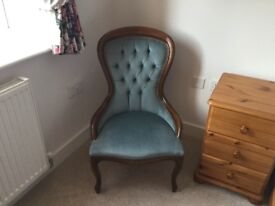 Turquoise blue nursing/occasional chair.
