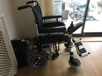 Pride LX 11 electric folding wheelchair, as new