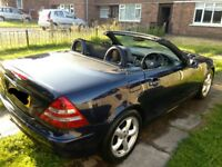 Rare Midnight Blue 51 plate SLK 320. Leather and walnut interior.