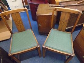 2 retro carved back chairs.
