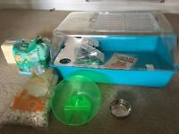 Nearly new hamster cage and accessories.