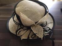 Beige/black hat.
