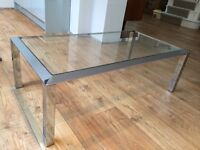 Glass top, chrome leg coffee table.