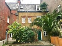 Beautiful, converted Coach House with 3 double bedrooms, a garden and off street parking