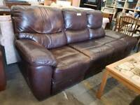 Large brown leather four seater sofa with reclining chair