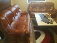 2 three seater real leather sofas