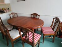 Extending dining room table with 6 chairs