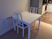 White Ikea Dining Room Table and Two Chairs. Seats two - extends to seat four. Excellent condition.
