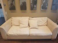 Large cream fabric sofa for sale
