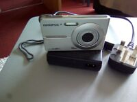 Olympus camera not used comes with battery charger