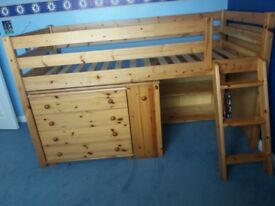 Solid pine single cabin bed frame with pull out table, set of 4 drawers and book cupboard.