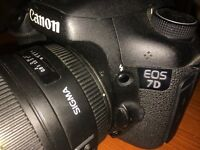 Canon 7D Digital Camera with 50mm Sigma Lense. Good condition. 4 batteries and 32gb card