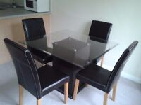 Modern dining table and four chairs