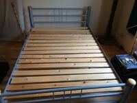 Double bed frame with wooden slats