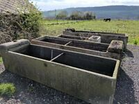 weathered large concrete stone troughs, perfect as a planting trough
