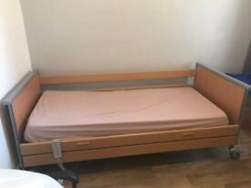 Electric profiling bed with mattress