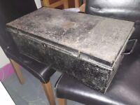 Small black metal antique uniform trunk. 2 ft x 1 ft x 8.5 inches deep.