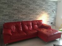 For sale Red leather corner sofa with matching footstool