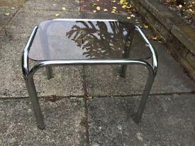 Glass and chrome simall sde table.