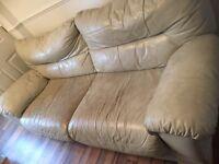 Free 3/4 seater cream leather sofa.