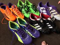 4 pairs of adidas football boots and 1 puma