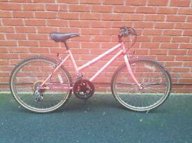 Pink child's Apollo Nitro bike
