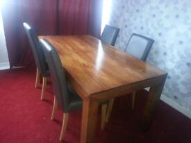 dinning table with four lether chairs