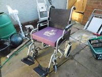 FOLDING WHEELCHAIR AS NEW HAS 18 INCH SEAT WITH CHUNKY SEAT CUSHION CAN DELIVER