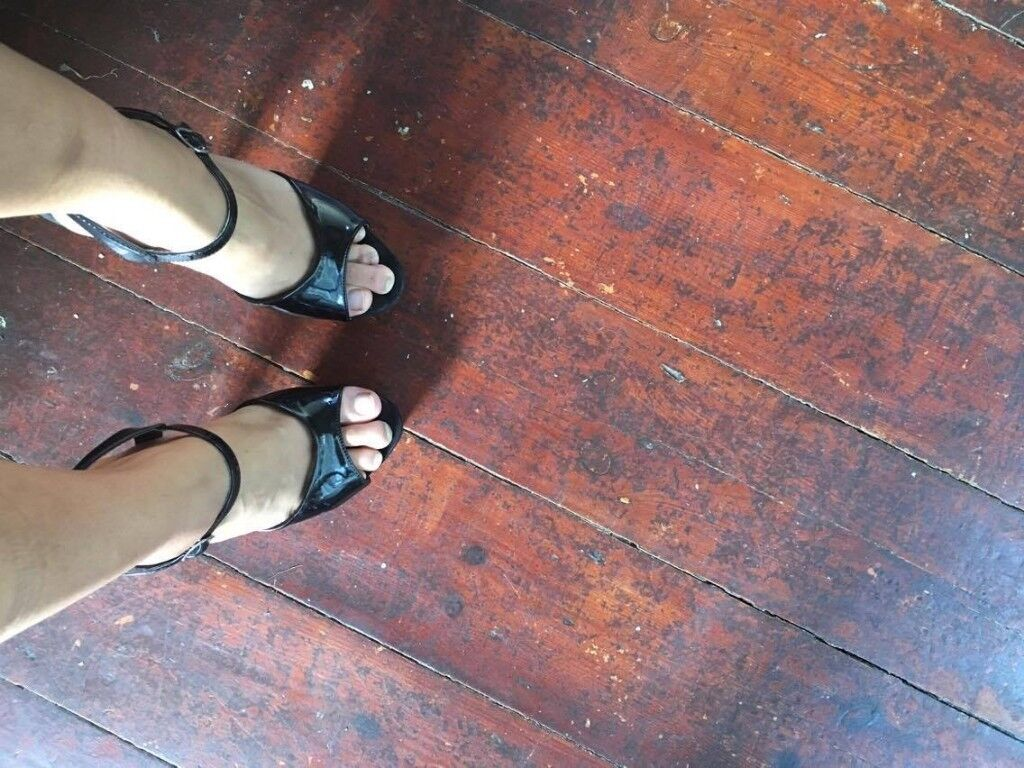 Trashed well-worn used black platform pleaser heels