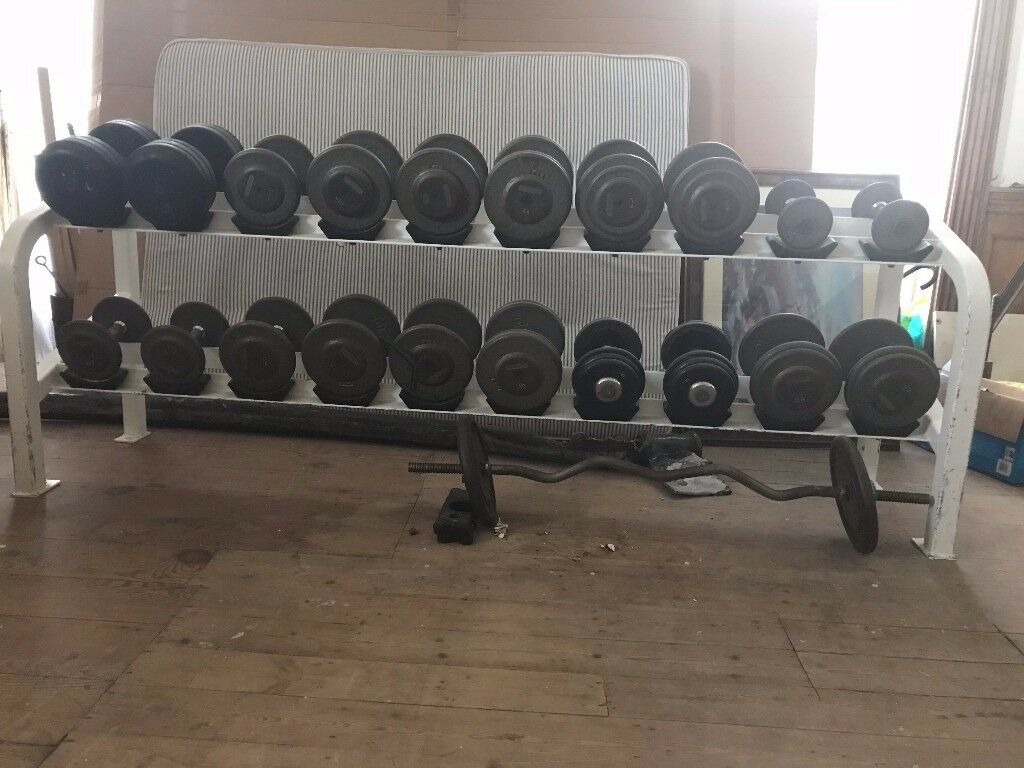 I am selling a professional weight set with a gantry storage rack .