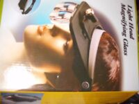 Multi functional head magnifying glass with wide scope 3D lens.