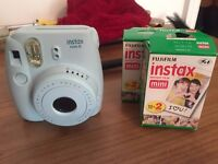 Powder blue polaroid camera (incl. 3+ packs of polaroids + leather carry case)