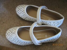 Girl's white shoes - size 10